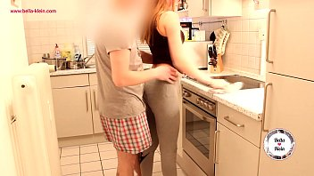 Sister and brother have fun in the kitchen