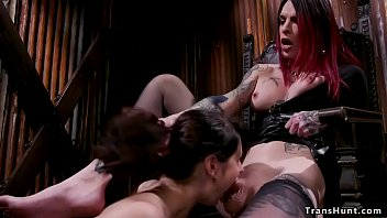 In a rusty dungeon tall big tits and big dick alt shemale Chelsea Marie makes her caged brunette slave Violet Monroe suck her dick