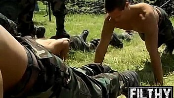 Army dude gets hosed down by hot and hunky comrades