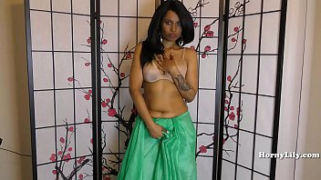 Indian milf teasing in green saree
