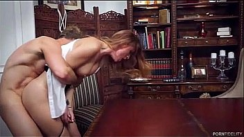 Passionate redhead fucked in office