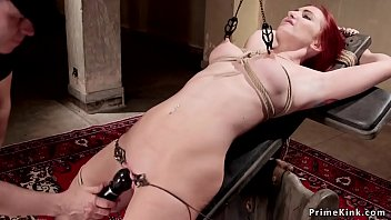 Beautiful gagged redhead slut gets pussy lips clamped