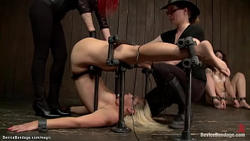 Lezdoms Claire Adams and huge boobs redhead MILF Mz Berlin put blonde lesbian slave Tara Lynn Foxx in device bondage and torment and fist her