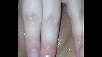 My wife playing with her wet pussy