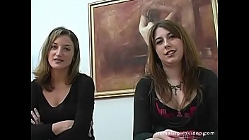Two amateur brunettes jerk and suck a cock