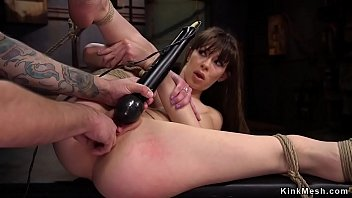Dark haired slut gets pussy fist fucked by her master trainer