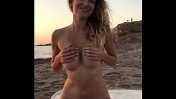 Amelie Lei is sucking and riding his cock on the beach! Super public! Quick sex