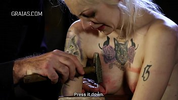 Shy slave nailed to a plank
