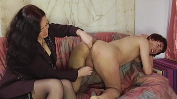 Mature woman straps on the ass of a young boy Vol. 1