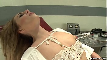 Skinny brunette solo babe Roxy Rox milking her titties in gyno chair then stripping off and fucking red dildo machine and squirting, free sex video