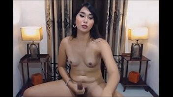 Horny Asian Shemale Sucking her Own Cock