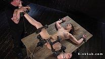 Brunette slave Dani Daniels in metal device bondage with locked legs