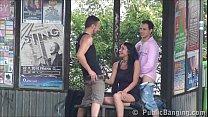 A cute busty woman is fucked by 2 guys in publi...
