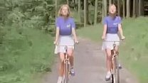 Blonde teens ride bikes صورة