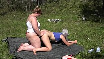 Lesbians with big asses have fun in nature. BBW...