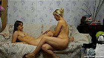 Two Sexy Girls Having Fun On A Couch صورة
