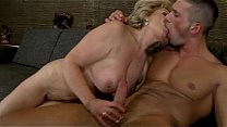 Hairy granny rides a young guy's dick