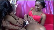 Two black lustful chicks fuck each other's puss...