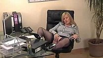 Watch busty blonde secretary in blue stockings at the office preview