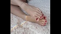 these gorgeous feet and red toes will turn you on