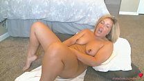 Hot step mother shows her big pierced tits while using a dildo on cam صورة