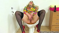 British mature Tammy gets very excited in the bathroom and plays with a rubber cock Thumbnail