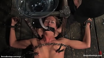 Naked huge boobs lezdom Isis Love makes shackled brunette slave Ariel X ride wooden pony while getting hard whip in group device bondage action