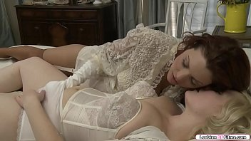 Busty blonde is on the bed masturbating and after that.She falls asleep and suddenly,redhead babe goes to her and they start kissing each other.Next is redhead rubs blondes pussy before she licks it and in return she fingers redheads wet pussy. Thumbnail