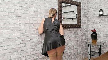 Leather dress teasing.