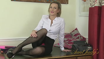 43 year-old British Office Lady Betsy working late at the Office in Stockings & High Heels