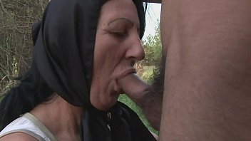 A naughty granny alone in the woods, meets a big and young cock to fuck