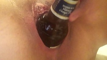 Beer bottle in pussy