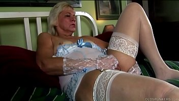 Kinky oldspunker in stockings frigs her hot cunt while talking nasty