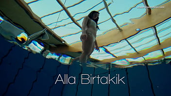 Alla Birtakik stripping and showing off her naked body in the pool