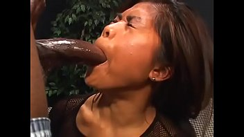 Asian beauty opens wide and takes a hard thick black cock down her throat,  cunt and arse