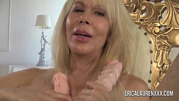 Hot blonde mom with big boobs fucks herself with two dildos