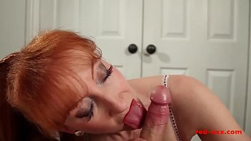 Watch Busty redhead MILF Red jerks her mans cock before riding it preview