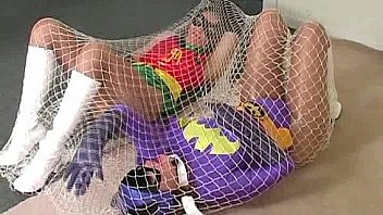 BatGirl trapped in a net