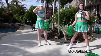 Slutty cheerleader trio having fun with cock outdoors