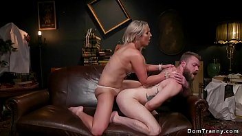 Watch Busty blonde shemale Kayleigh Coxx gets blowjob from beardy Mike Panic then anal fucks him in doggy style on the couch till gives him facial cumshot preview