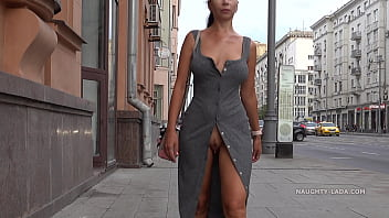 Naughty Lada is walking in public with an open pussy