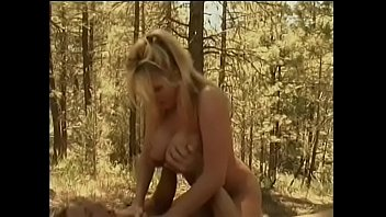 Sexy busty blonde whore rides hard dick by her twat at the forest
