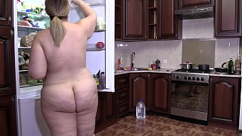 Nude chubby girl with big booty and shaved pussy making pie in the kitchen