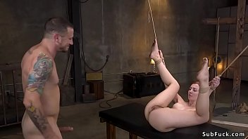 Hairy pussy ginger slave Megan Winters in bondage with vibrator on her clit and nipples clamp gets whipped by master then in other position tormented