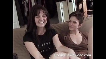 Petite brunette amateur fucks her sexy girlfriend with a strap-on dildo