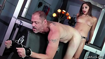 Big ass raven haired mistress Abella Danger in red thong lingerie torments gagged man slave in leather pants then anal fucks with strap on dick and gives face sitting