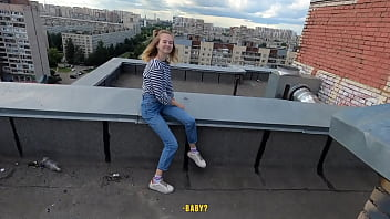 extreme sex on the roof of a skyscraper with cum on face and a beautiful view.
