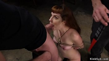 Watch Gagged redhead babe in bondage gets whipped then her master makes her gag huge dick to other master preview