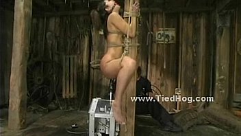 Blonde tied on chair in dirty barn bdsm