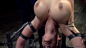 Big tits pawg brunette lesbian slave Phoenix Marie is locked in metal doggy style device and gets anal fisted by big tits lezdom Aiden Starr